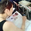 Sessão de autógrafos no stand Pandemônio, no FIQ 2013. Foto: Mitie Taketani (Itiban Comicshop)